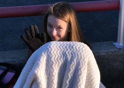 Amber Griswold keeping warm between filming on Jay Leno's Garage